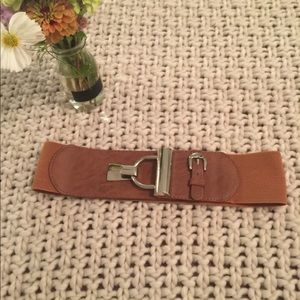 tan and silver buckled mid belt